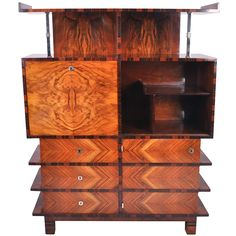 Lajos Kozma Art Deco Cabinet  Hungary  c. 1920's  Lajos Kozma, the acclaimed early 20th century Hungarian architect, designed this cabinet with exquisite details. This piece features open and closed shelving, drawers, macassar and walnut veneers and chrome details.
