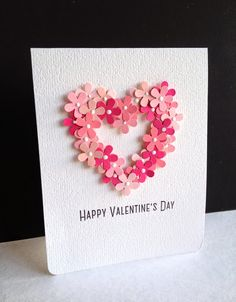 handmade Valentine card ... clean and simple ... subtle texture on background paper ... heart of punched five-petal flowers in pinks ... attached with glossy accents and dotted with enamel accents ... luv it!