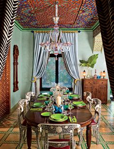 Indian inspired dining room. I love the chairs. No idea how they have decorated that ceiling but it would be cool to do in a smaller room