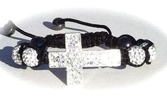 I have this one, would love tho have a silver faith bracelet to go with it♥  Cross Shamballa Bracelets
