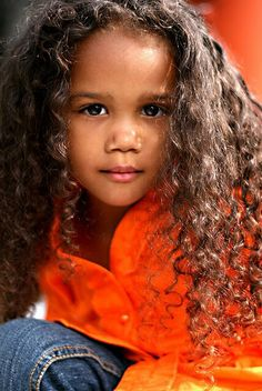 Such a beautiful little girl. I love her curls.