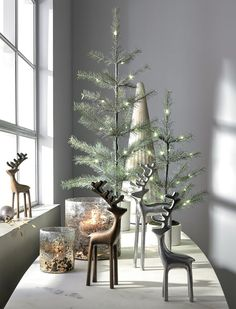 Silver Reindeer at Crate and Barrel Canada. Discover unique furniture and decor from across the globe to create a look you love. Modern Christmas Decor, Farmhouse Christmas Decor, Simple Christmas, Christmas Home, Holiday Decor, Coffee Table Christmas Decor, Christmas Trees, Scandinavian Christmas Decorations, Winter Home Decor