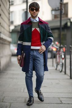 Choose a multi colored overcoat and blue skinny jeans if you're going for a neat, stylish look. Elevate this ensemble with black leather double monks.   Shop this look on Lookastic: https://lookastic.com/men/looks/overcoat-crew-neck-sweater-dress-shirt/23539   — Dark Brown Sunglasses  — Light Blue Dress Shirt  — Multi colored Geometric Crew-neck Sweater  — Multi colored Overcoat  — Burgundy Leather Zip Pouch  — Blue Skinny Jeans  — Black Leather Double Monks