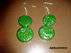 This earrings have been made of green fimo and silver sheets.