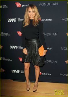 Nicole is wearing a Thierry Mugler top, a Winter Kate skirt, Jimmy Choo shoes, a Chanel bag, and House of Harlow skull studs.