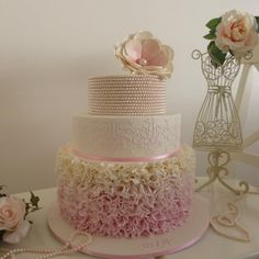 This is actually a Christening cake, but could very easily be a wedding cake.  http://www.creativecakedesign.com.au/about.html