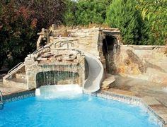 This vinyl-liner pool is packed with fun elements: a slide, waterfall and even a cave — with fossils!