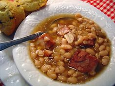Crock Pot Ham and Beans from Food.com:   This is cheap eating at it's best. Really good for scraping by at the end of the month if your cash gets low. Goes best with freshly baked corn muffins drizzled with honey.