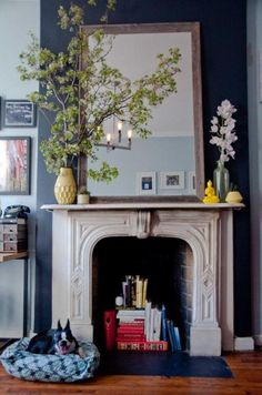 Elements of a lovely mantel | Life in Grace  Hers are pretty full :), but she give good tips for what components make up a pretty one.