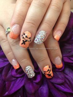 Acrylic nails…peach polish and glitter with Swarovski crystals and freehand nail art