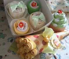Cute gift idea for a baby shower!  Washcloths and blankets wrapped as cupcakes and flowers.