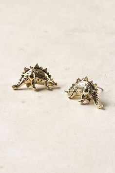 Prehistoric Posts - Dino earrings. Now I've seen everything. Apparently sweet HK knows exactly what is on trend right now.