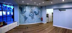 Travel Agency The Destination Lounge opted for a stylish blue world map atlas to breath life into their office