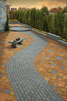 Cambridge Pavers grey brick stone path set in contrasting patio pavers.