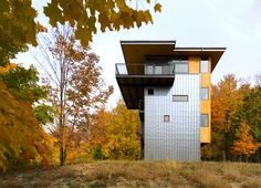Balance Associates' Sustainable Metal-Clad Tower House Overlooks Michigan's Glen Lake