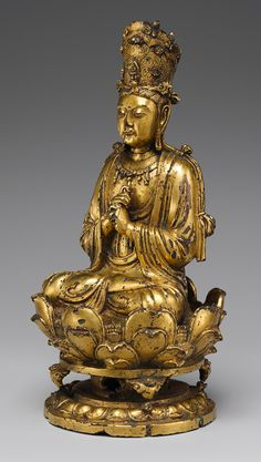 Buddha Vairochana with the wisdom fist: the right fist enclosing the index finger of the left. A celestial Buddha important in Asia from the 8th to the12th C. e. 11th C.  Liao dynasty - Mongol Rule - China. Gilt bronze