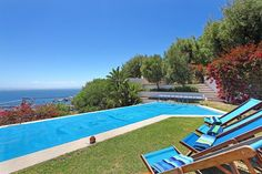 This lovely 4 Bedroom Simonstown Holiday Accommodation; 4 en-suite bedrooms and is designed to accommodate 8 persons.  Are you looking for a most cool holiday home to break away from Covid?   Long stay discounts and an extra 10% if you repin and share THIS pin on either Facebook or Twiiter.   One with a view from each room, the lounge? Every home is it's own floor. Private with a view and en-suite.  The architectural design was for a holiday home & is intentionally minimalist..... Cape Town Holidays, Pictures Plus, Romantic Pictures, Holiday Accommodation, Bedroom With Ensuite, Garden Pool, Stunning View, Great View, Modern Luxury