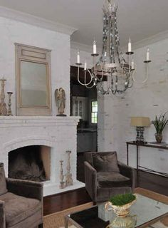 White/gray brick, metallic velvet chairs, rustic wood pieces, and simple yet girly chandelier.