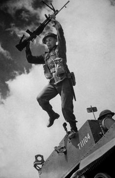 1940: An Australian soldier leaps from a tank during training exercises in Britain. (Photo by Fox Photos/Getty Images)