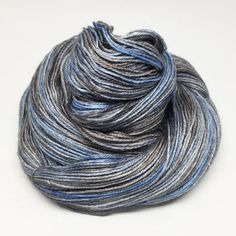 This yarn is absolutely spectacular. It's perfect for socks, as BFL is a soft but hard-wearing fibre, and silk will add more strength andcomfort. It's also great for shawls and scarves,because it's beautifully drapey.It will look exquisite and feel luxuriously soft around your neck. Heaven.The colourway is a mix of turquoise, blue and soft grey-brown. I've named it after Sapphire and Steel, a TV show of the '70s featuring the ever-luminous Joanna Lumley and the gorgeous David McCallum as…