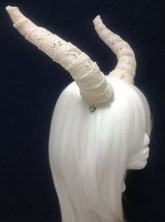 I gotta try this. I think it's just soaking the fabric in stiffener and letting it dry on a horn mold. Great idea for lightweight horns