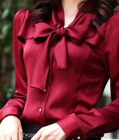 Love the rich color and over sized bow detail.