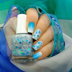"""""""Different Dimension Never Grow Up. Two coats alone on the ring finger and one coat over Essie Marshmallow on the middle finger."""""""