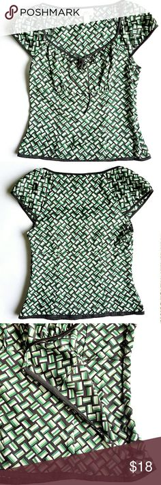 """LOFT Silky Blouse Beautiful silky blouse with ribbon bow detail. Unlined,  side zipper closure, cap sleeves.  100% polyester. 13"""" shoulder to shoulder,  16"""" armpit to armpit. Has one tiny imperfection on the left sleeve ( last pic) totally invisible when worn. Otherwise in excellent condition. LOFT Tops Blouses"""