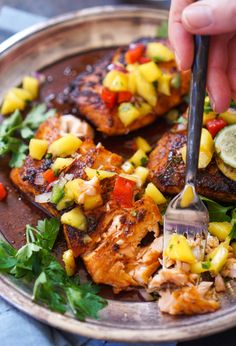 Salmon blackened in a garlic-thyme-lime butter with a homemade blackened seasoning and fresh mango salsa. Healthy, quick, and so YUM.