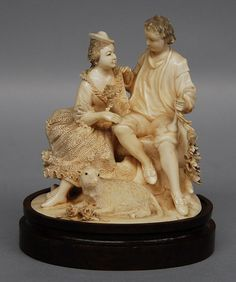 A romantic ivory carved group on a wooden base, H 17 cm