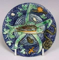 A completely charming Thomas Sergent French Palissy miniature cobalt blue ground fish charger. French c1875  Dimensions in Inches: Dia: 4.1 ins