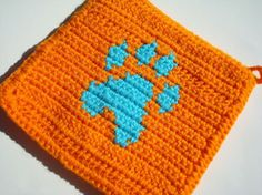 Orange and Blue Pawprint Potholder - Crochet Potholder - Dog Owner, Pet Owner, Dog Person, Pet Lover Gift  by Hoooked, $10.00