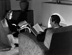 Man and woman reading by a fireside, 1950.    © NMeM / Photographic Advertising…