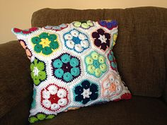 I have a recent obsession: African Flower Motifs! I'm not a huge fan of granny squares (and especially not a particular fan of connecting them!), but when I first saw an African Flower Motif, I was caught! It is such a beautiful design, and works with any color combos to form an exquisite garden! I decided to give one a try and used the African Flower Motif found here and her instructions are so clear and wonderful! On that blog, she posted a photo of a really neat pillowcase made from these…