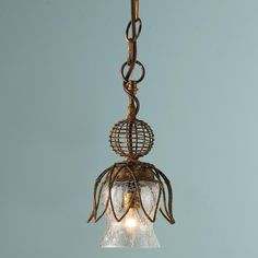 Rusty Tulip Mini Pendant-I like that it's different and a piece of art for the kitchen.