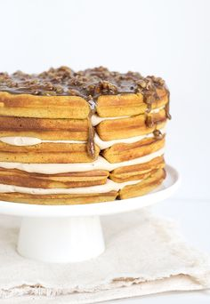 Pumpkin Pie Waffle Cake with a butter pecan glaze - spicy pumpkin waffles that are filled with a maple buttercream and topped with a butter bourbon pecan glaze.