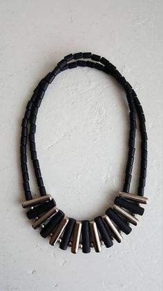 Finnish vintage necklace made by Aarikka in the Black wooden beads with metal parts, elastic rubber band. Lenght of the long-shaped beads / Good condition. Wooden Beads, Black Silver, Metal, How To Make, Vintage, Jewelry, Jewlery, Jewerly, Schmuck