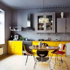 Kitchen Colour Schemes  Grey is a colour many people wouldn't associate with the kitchen but with an accent of bright  yellow colour, it's fun, sophisticated and anything but dull and dingy. Paint cupboards or give your dining table some citrus coloured seating. Easy.