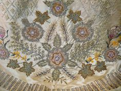 Queen Elizabeth II coronation gown Embroidery designed and executed by Royal School of Needlework, taking 3,500 hours to complete.