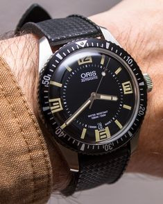 """Oris Divers Sixty Five Watch Review - by James Stacey - see it in action & all about it in the video, photos, & full review on aBlogtoWatch.com """"The Oris Divers Sixty Five is surprising. When I first saw the watch at Baselworld early last year, it stood out among the usual burly pro-style diving watches for which Oris is known. On the same table, I saw the impressive 48mm Aquis Depth Gauge Chronograph and the comparatively diminutive and unassuming Oris Divers Sixty Five..."""""""