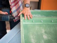 How to Create a Budget-Friendly Jewelry Organzier | HGTV Diy Jewelry Cabinet, Diy Jewelry Hanger, Building A Door, Build A Wall, Perforated Metal, Decorative Knobs, Create A Budget, Wipe Away, Rustic White
