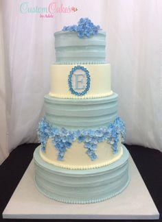 Dusty blue wedding cake with sugar hydrangeas.