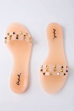 A little edgy, a little retro, the Jett Nude Studded Jelly Slide Sandals are our newest shoe crush! These flexible jelly sandals have a trio of toe straps, decorated with gold pyramid studs. Slide on design. Shoes Flats Sandals, Jelly Sandals, Girls Sandals, Cute Sandals, Slide Sandals, Cute Shoes, Jelly Slides, Bow Slides, Sock Shoes