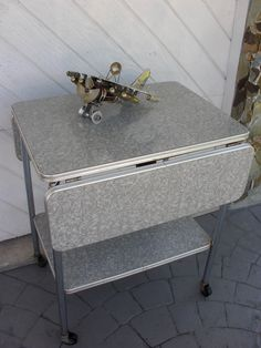 AWESOME 50s KITCHEN DROP LEAF SERVING CART MID CENTURY TABLE MOD PEARL FORMICA | eBay $34 plus $35 shipping