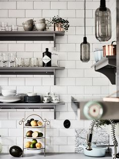 A serene Swedish home in muted green and grey