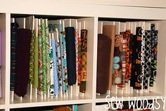 Great idea for organizing small bits of fabric. Thinking I could size the foam core to just fit the IKEA Expedit shelves.