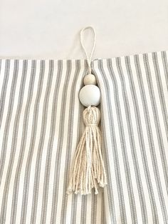 Do it yourself Pottery Barn Inspired Gray and white ticking stripe curtains with DIY tassels!