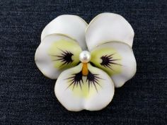 I think this one is especially lovely. Antique Art Nouveau 14K Enamel Enameled Pearl Pansy Flower Brooch Pendant