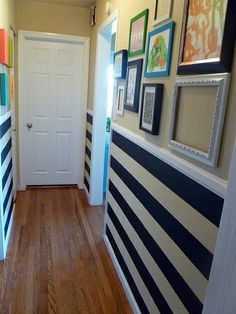 I love the combo of the black & white stripes with the colorful gallery wall.  (It's about the same width as our hallway.)