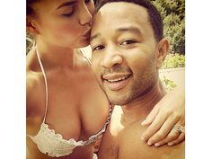 Chrissy Teigen and her husband John Legend shows her pic on Instagram that includes her engagement ring and two new wedding bands .  The 27-year-old star's matching rings surround her (completely ginormous) cushion-cut diamond engagement ring. It appears the delicate pieces coordinate with her engagement ring and feature tiny diamonds all the way around.